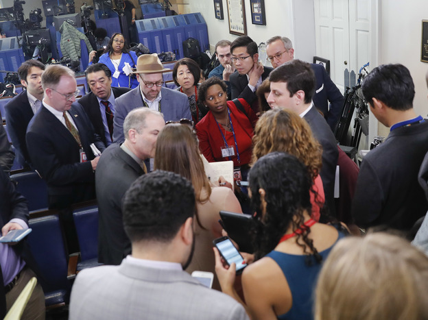White House reporters line up Friday in Washington in hopes of attending a briefing in press secretary Sean Spicer's office. The off-camera briefing was limited mostly to pool reporters, broadcast networks and conservative-leaning outlets, with reporters for CNN, <em>The New York Times,</em> the <em>Los Angeles Times</em> and others denied entry.