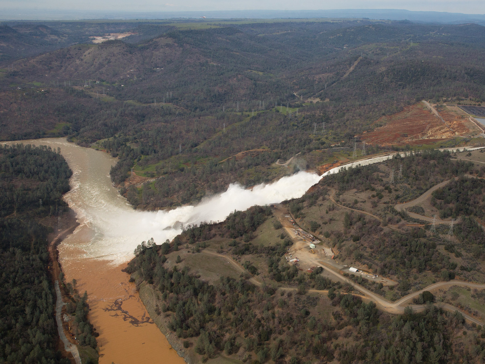 Almost 200,000 people were ordered to evacuate after a hole in the emergency spillway in Northern California's Oroville Dam threatened to flood the surrounding area. Climate change could be a factor of extreme flooding in California. (Elijah Nouvelage/Getty Images)