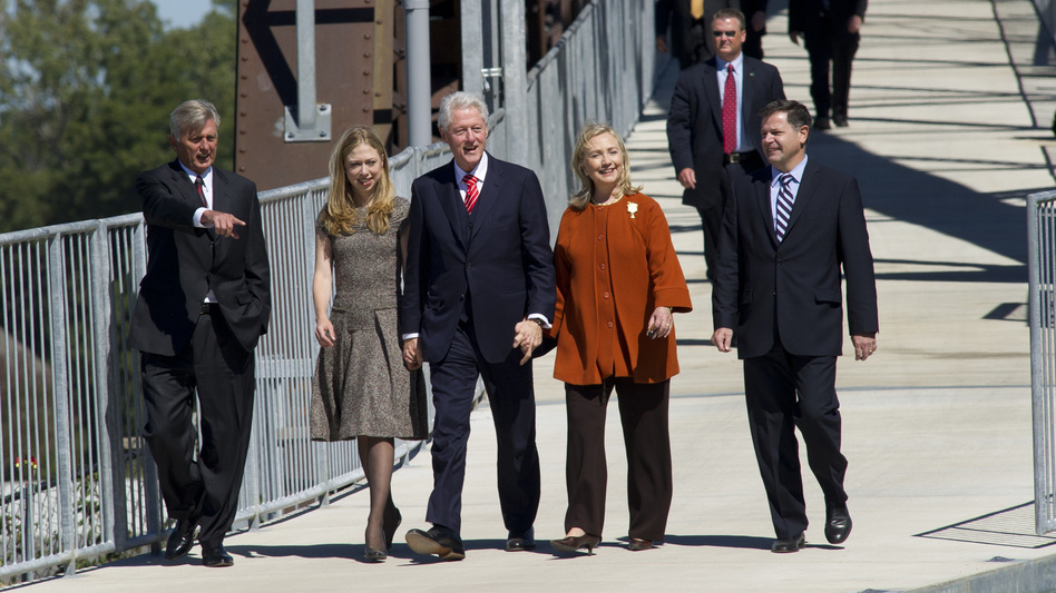 The Clintons attend a 2011 dedication ceremony for a pedestrian bridge in Little Rock, Ark., located adjacent to former President Bill Clinton's presidential library.