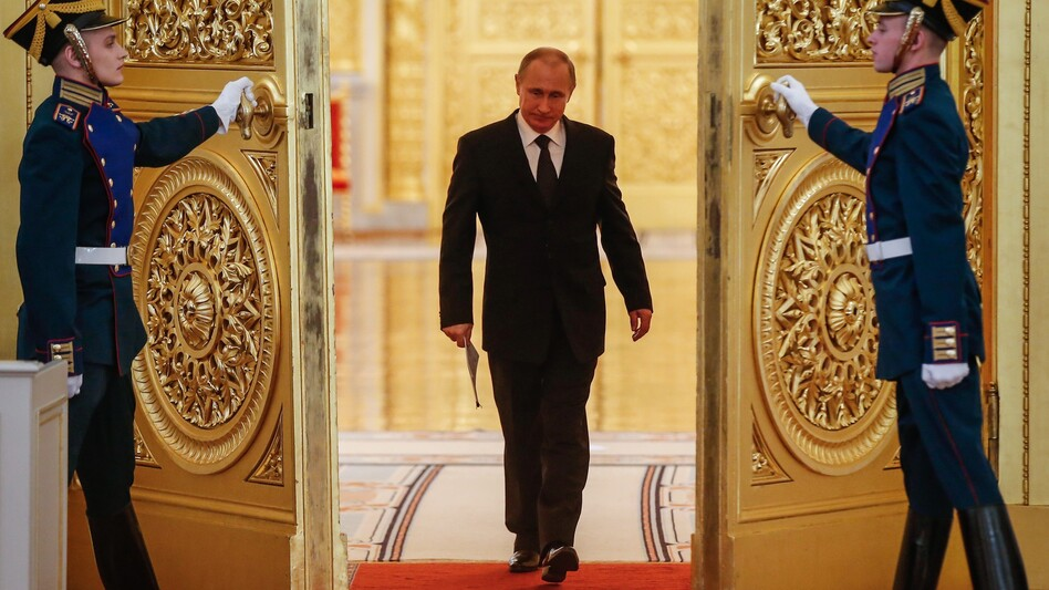 Russian President Vladimir Putin enters a hall in the Kremlin before a meeting in 2015. (Sergei Ilnitsky/AFP/Getty Images)
