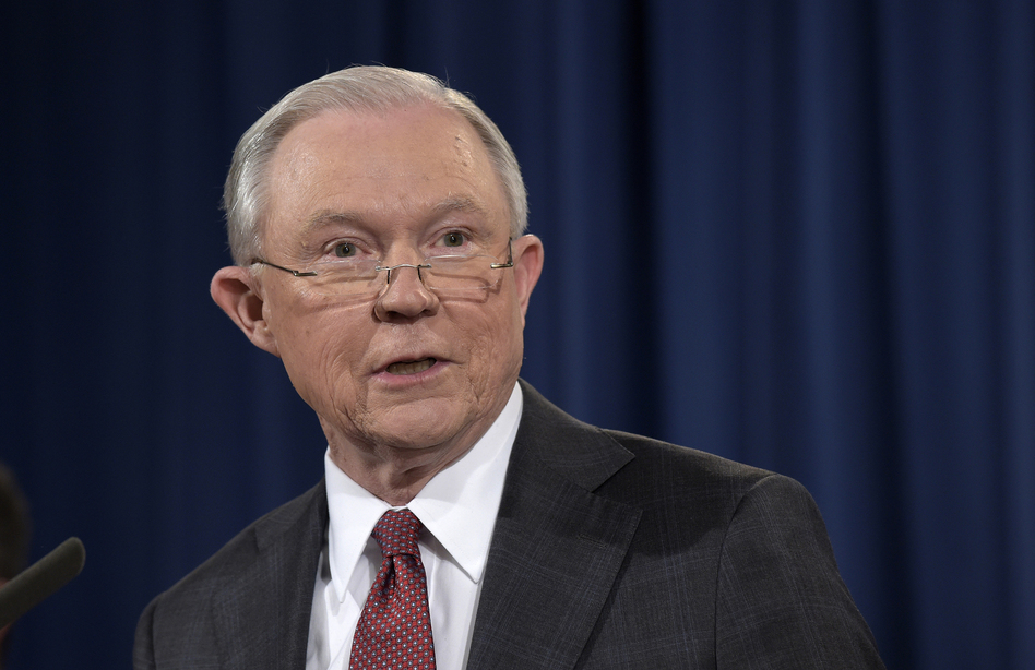 Attorney General Jeff Sessions speaks at the Justice Department on Thursday. He is under fire after reports that he had conversations with the Russian ambassador last year. (Susan Walsh/AP)