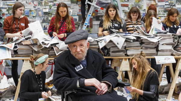 Students from Central Saint Martins art school in London work behind Gustav Metzger, after his worldwide call for a Day of Action to Remember Nature in 2015.