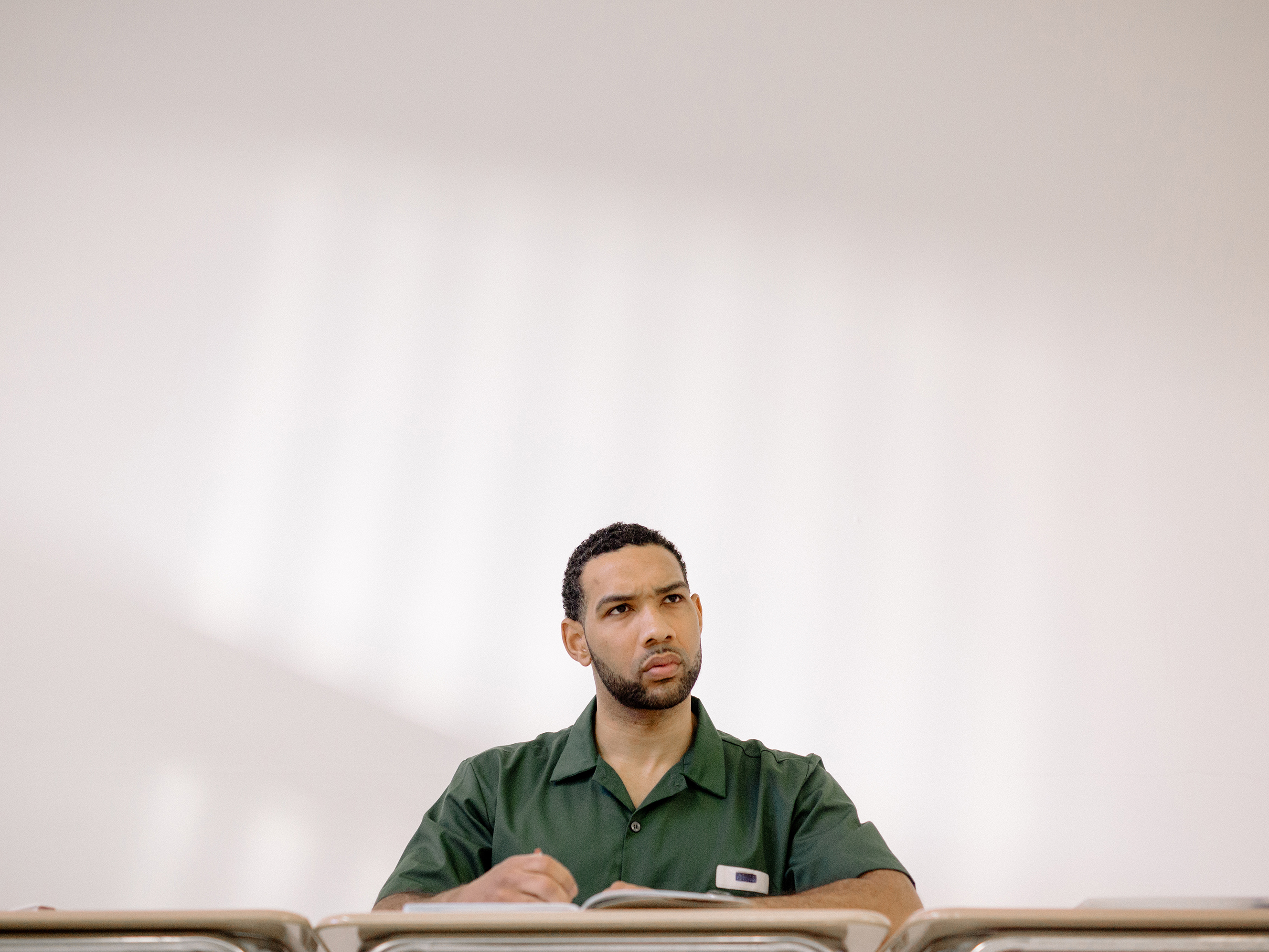 Dyjuan Tatro, 31, has served 11 years for violent gang and drug crimes. He is a math major with a 3.72 GPA and was part of the team of inmates who beat Harvard in a debate. (Cameron Robert/NPR)