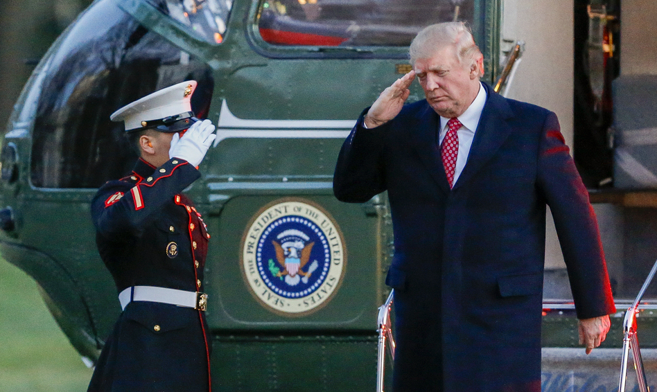 President Trump salutes as he disembarks Marine One on the South Lawn of the White House on Sunday. Trump signed a new executive order on travel and refugee resettlement on Monday. (Erik S. Lesser/Pool/Getty Images)