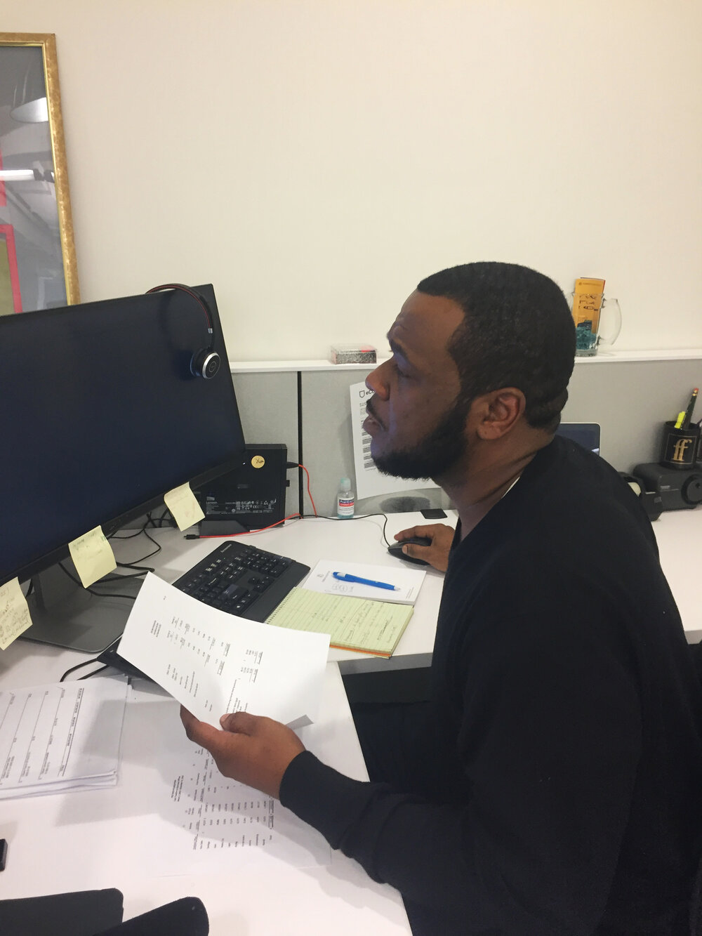 Lavar Gibson working at a computer desk.