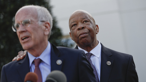 Rep. Elijah Cummings, D-Md., listens as Rep. Peter Welch, D-Vt., speaks to members of the media Wednesday outside the West Wing of the White House in Washington following their meeting with President Trump.
