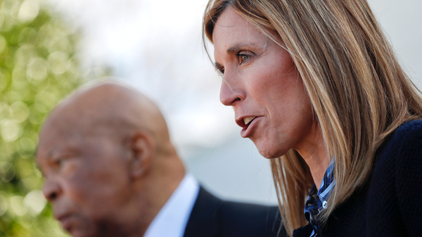 Redonda Miller (right), president of Johns Hopkins Hospital, and Rep. Elijah Cummings, D-Md., speak to journalists after their White House meeting Wednesday with President Donald Trump on the high cost of prescription drugs.