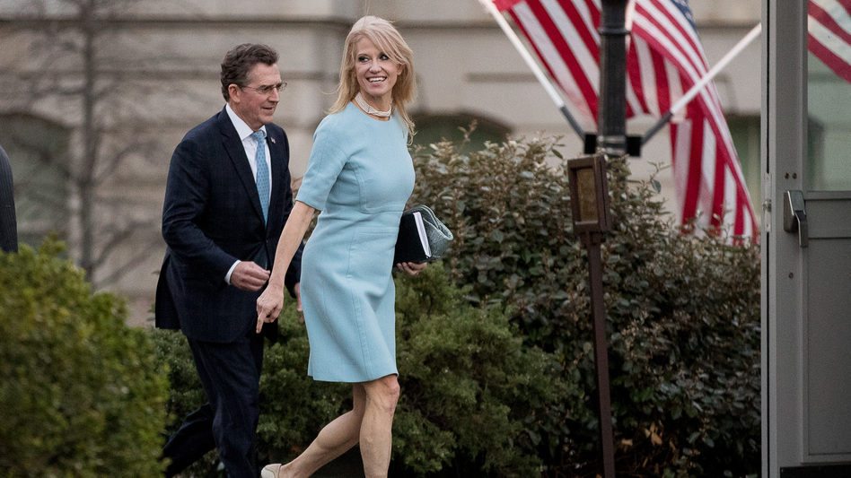 Counselor to the President Kellyanne Conway (right) and former Sen. Jim DeMint, now president of the Heritage Foundation, walk away from the West Wing of the White House on Wednesday. The White House declined to discipline Conway for a lapse in a recent on-air interview, rebuffing the Office of Government Ethics. (Andrew Harnik/AP)