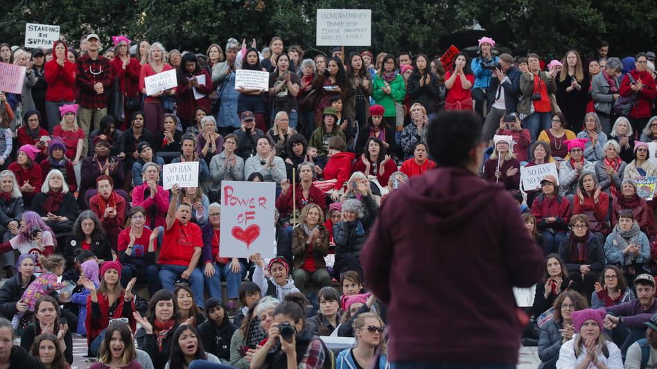 Men and women mark International Women's Day in Oakland, California.