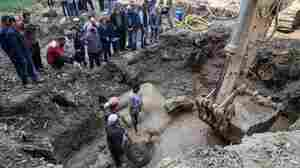 Massive Ancient Statue Discovered Submerged In Mud In Cairo