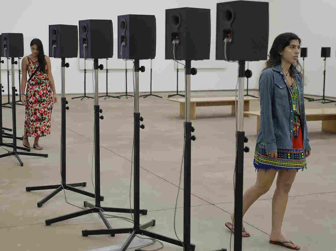 People visit Janet Cardiff's art installation last November at the Inhotim Institute, in Brumadinho, Brazil.