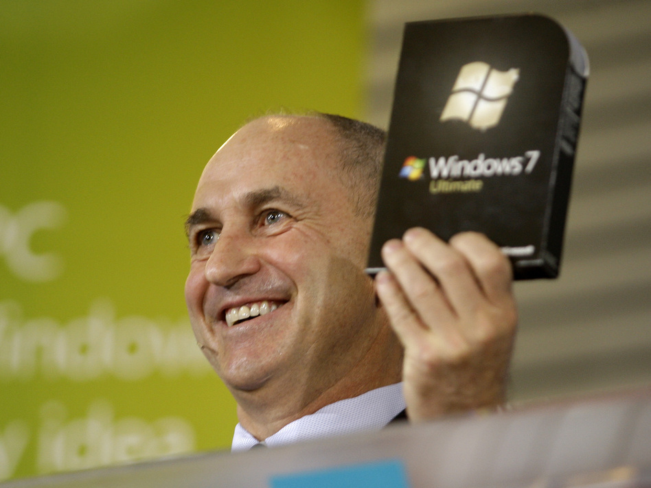 Chris Liddell, then CFO of Microsoft Corp., holds up a copy of the Windows 7 computer operating system during a rally to celebrate its release in October 2009. (Ted S. Warren/AP)