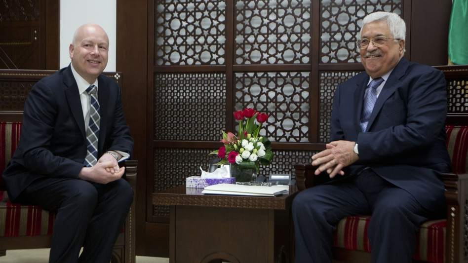 President Trump's peace envoy Jason Greenblatt (left) meets with Palestinian President Mahmoud Abbas in Ramallah in the West Bank on Tuesday. (Majdi Mohammed/AP)