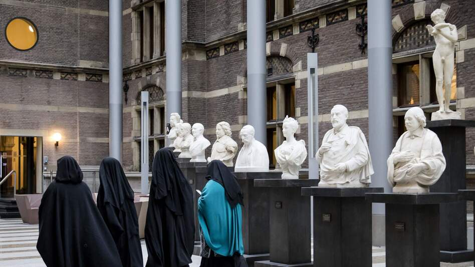 A European court has sided with employers who restrict Muslim women from wearing Islamic headscarves. Here, women wearing niqab visit the Dutch Senate last November, as restrictions on Islamic head coverings were being debated. (AFP/Getty Images)