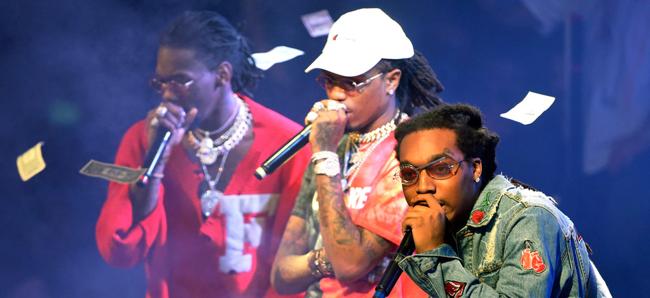 Migos performs at a nightclub in Las Vegas in February, following the <em>release</em> of its album <em>C U L T U R E</em>, which debuted at No. 1 on the <em>Billboard </em>album chart. (David Becker/Getty Images)