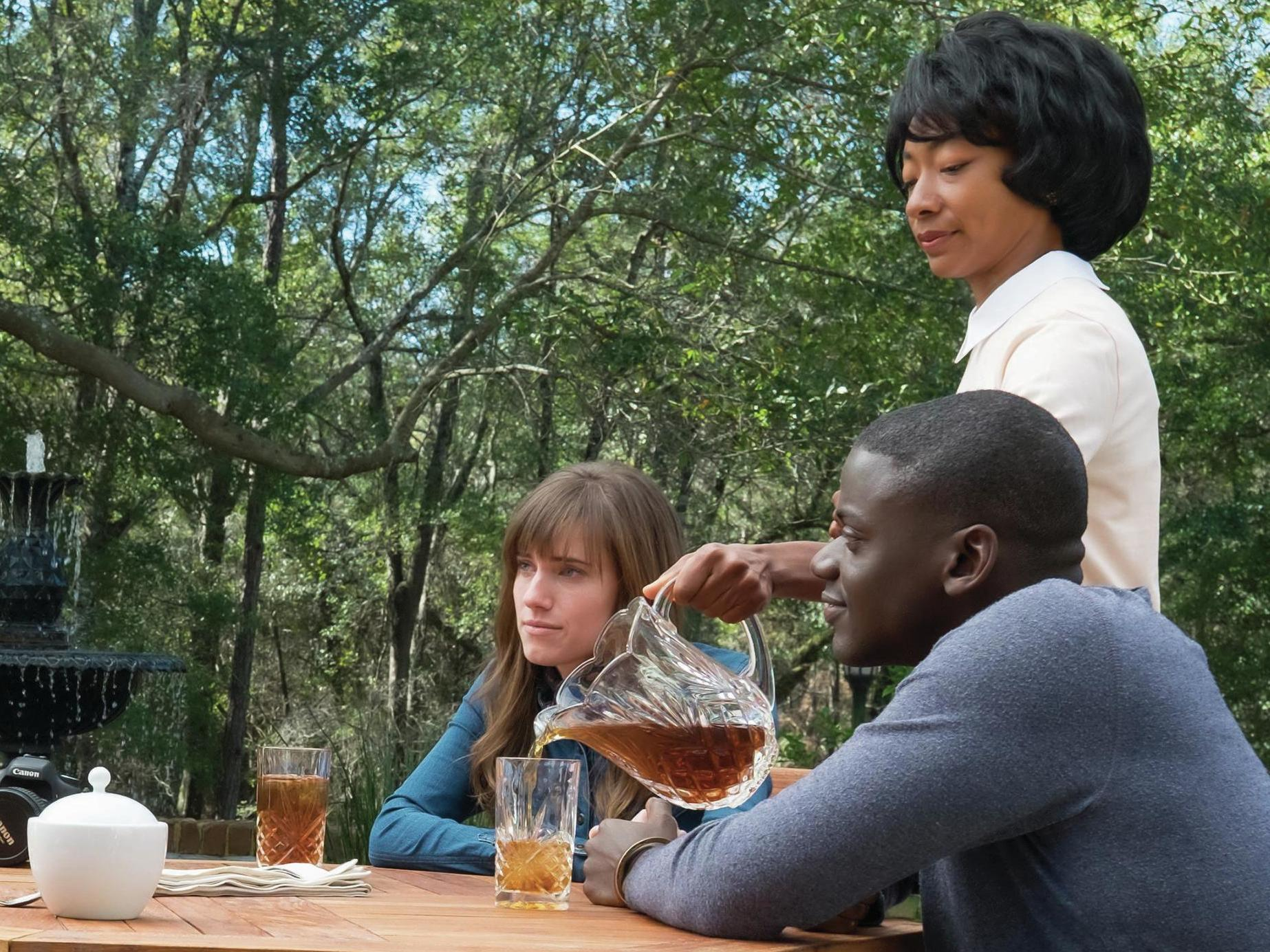 Chris sits down for tea with Rose's parents in 'Get Out.' (From left, Catherine Keener, Bradley Whitford, Allison Williams, Betty Gabriel and Daniel Kaluuya). Justin Lubin/Universal Pictures