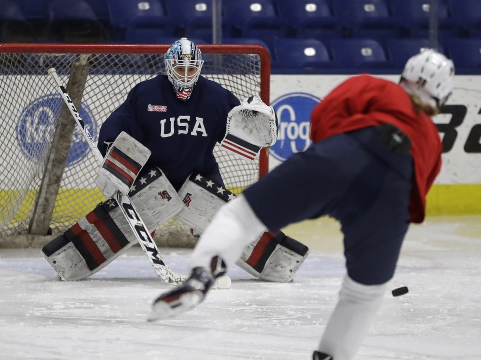 Team USA hockey goalie Alex Rigsby defends the goal during a practice session in Plymouth Township, Mich., in December 2016. (Carlos Osorio/AP)