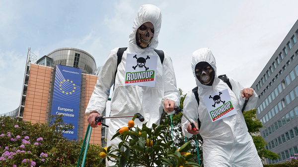 Last May, members of the Avaaz civic organization dressed as crop-sprayers in Brussels to protest the European Commission