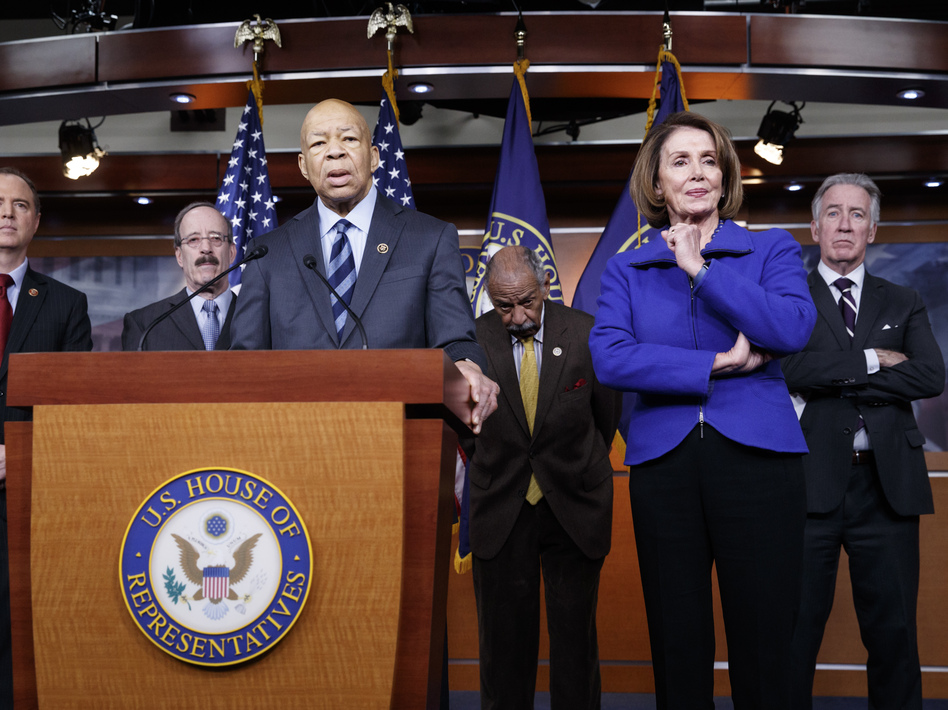 Top House Democrats, including Rep. Elijah Cummings, D-Md. (at the podium), said this week they want an investigation into President Trump's connections with Russia, such as when he learned that his national security adviser, Michael Flynn, had discussed U.S. sanctions with a Russian diplomat. (J. Scott Applewhite/AP)