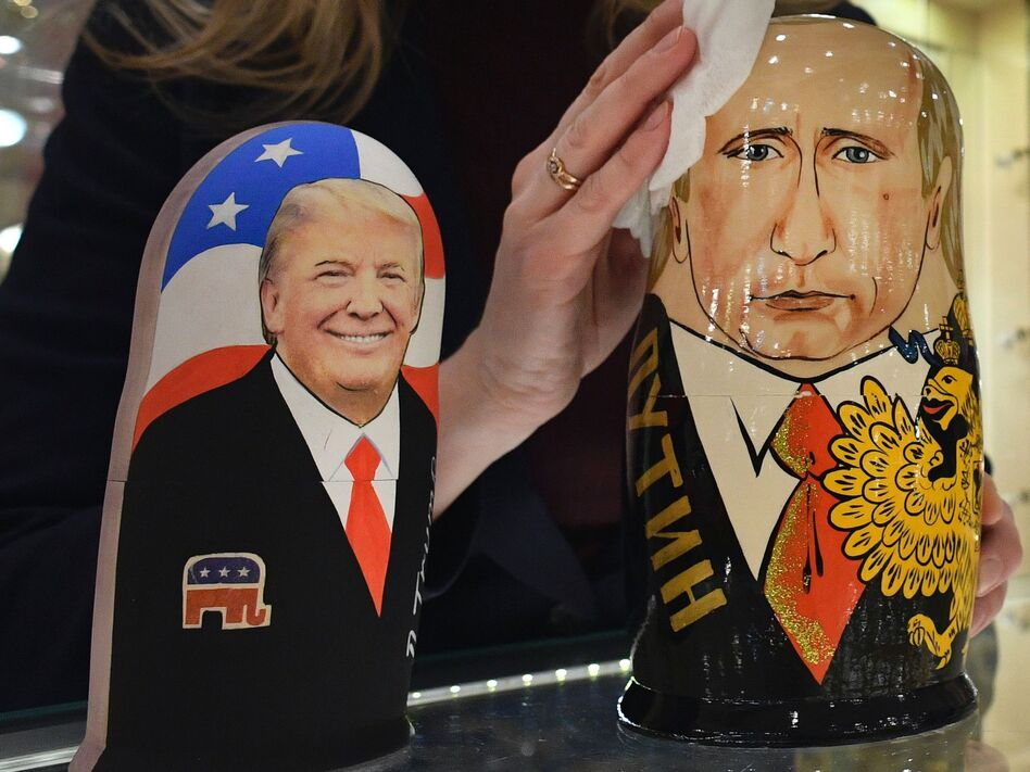 An employee at a Moscow gift shop polishes traditional Russian wooden nesting dolls depicting Donald Trump and Russian President Vladimir Putin. (Alexander Nemenov/AFP/Getty Images)