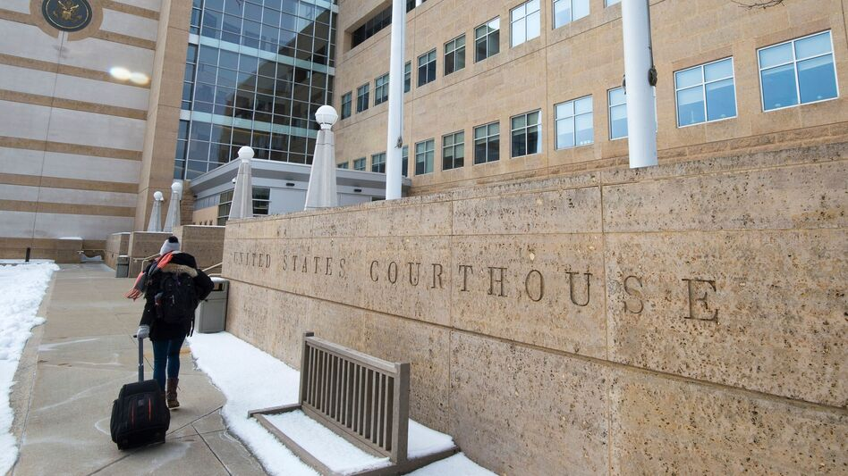 A person enters the U.S. District Court in Greenbelt, Md., on Wednesday. A judge there imposed a preliminary injunction blocking part of President Trump's new travel ban from going into effect. (Paul J. Richards/AFP/Getty Images)