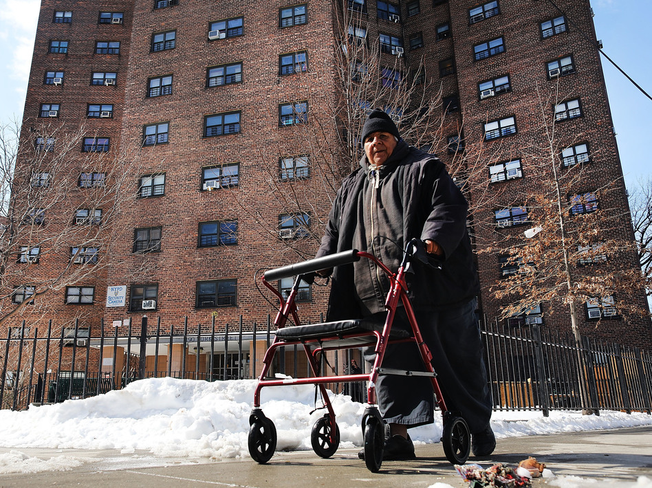 A man walks by the Farragut Houses, a public housing project in Brooklyn, N.Y. The budget blueprint President Trump released Thursday calls for the cutting of billions of dollars in funding from the Department of Housing and Urban Development. (Spencer Platt/Getty Images)