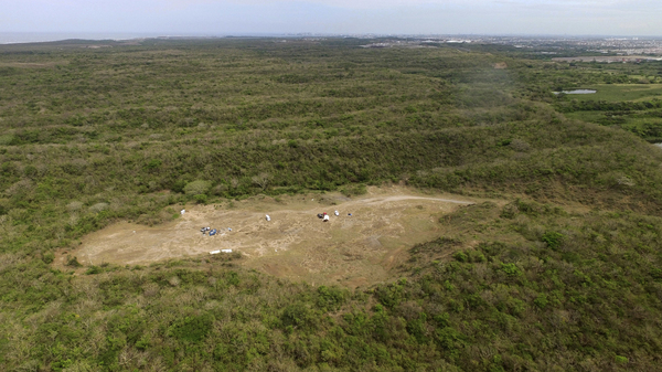 This aerial image shows the area known as Colinas de Santa Fe where Mexican authorities work to find the remains of people buried in mass graves on the outskirts of Veracruz. More than 250 skulls were found there earlier this year in what appears to be a drug cartel