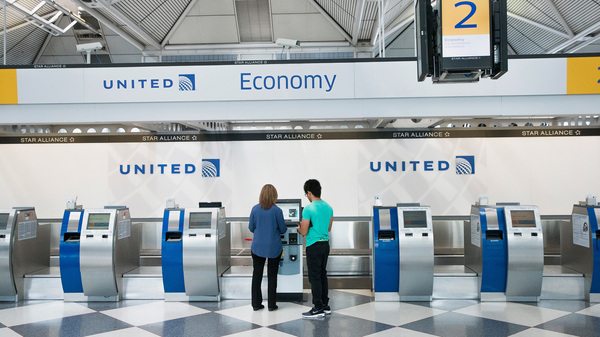 Passengers check in for flights with United Airlines at Chicago O