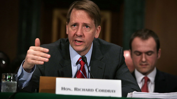 Richard Cordray, director of the Consumer Financial Protection Bureau, testifies before a Senate committee last year. The Trump administration is trying to bring the independent bureau under the president