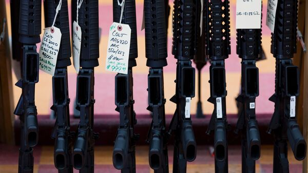 A House-approved bill would require a court hearing before a U.S. veteran is deemed mentally unfit to own a gun. Here, rifles are seen at a gun shop in Merrimack, N.H., last year.