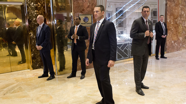A Secret Service detail clears out the Trump Tower lobby for then-President-elect Donald Trump on Jan. 13 in New York City. A Secret Service employee
