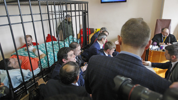 Roman Nasirov (left, in orange), the suspended head of Ukraine