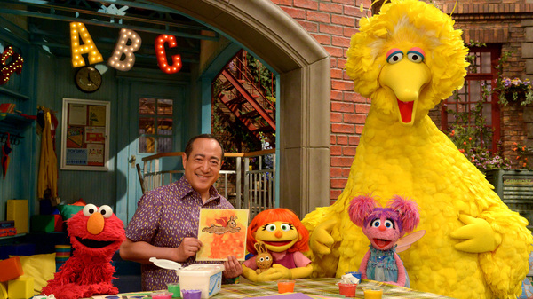 Julia (center) first appeared online and in printed materials as a part of Sesame Street