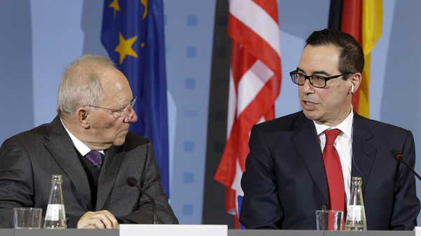 U.S. Treasury Secretary Steven Mnuchin, right, and German Finance Minister Wolfgang Schaeuble, left, address the media during a joint press conference in Berlin, Germany, on Thursday in advance of the weekend