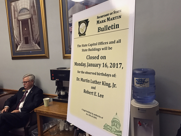 A notice marking the dual holiday honoring Confederate Gen. Robert E. Lee and slain civil rights leader Martin Luther King Jr., as posted at a Senate Education Committee hearing in Little Rock, Ark. Gov. Asa Hutchinson signed a law separating Lee from the King holiday.