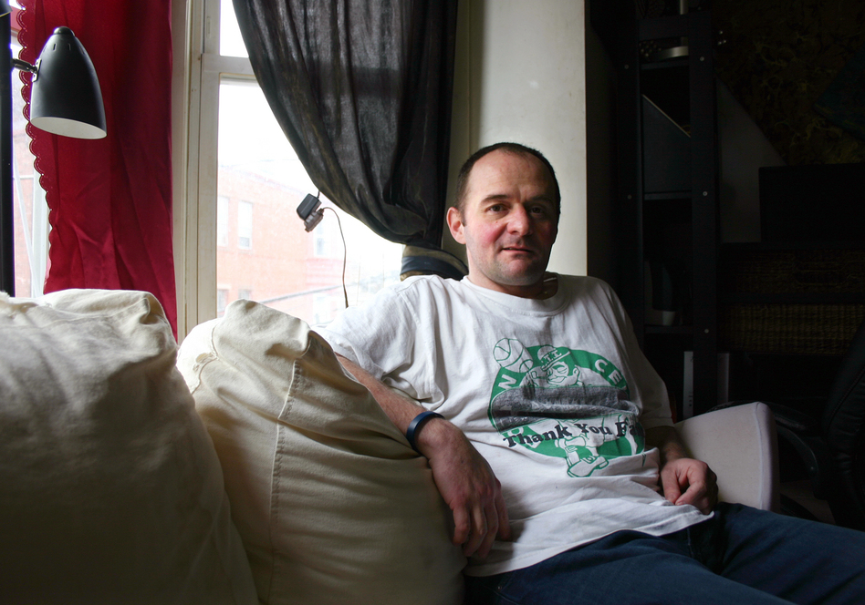 Christopher Milford in his apartment in East Boston, Mass. He quit abusing opioids after getting endocarditis three times. (Jack Rodolico/NHPR)