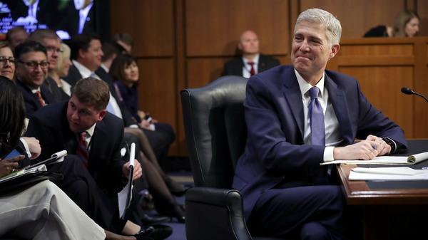 Judge Neil Gorsuch listens to senators