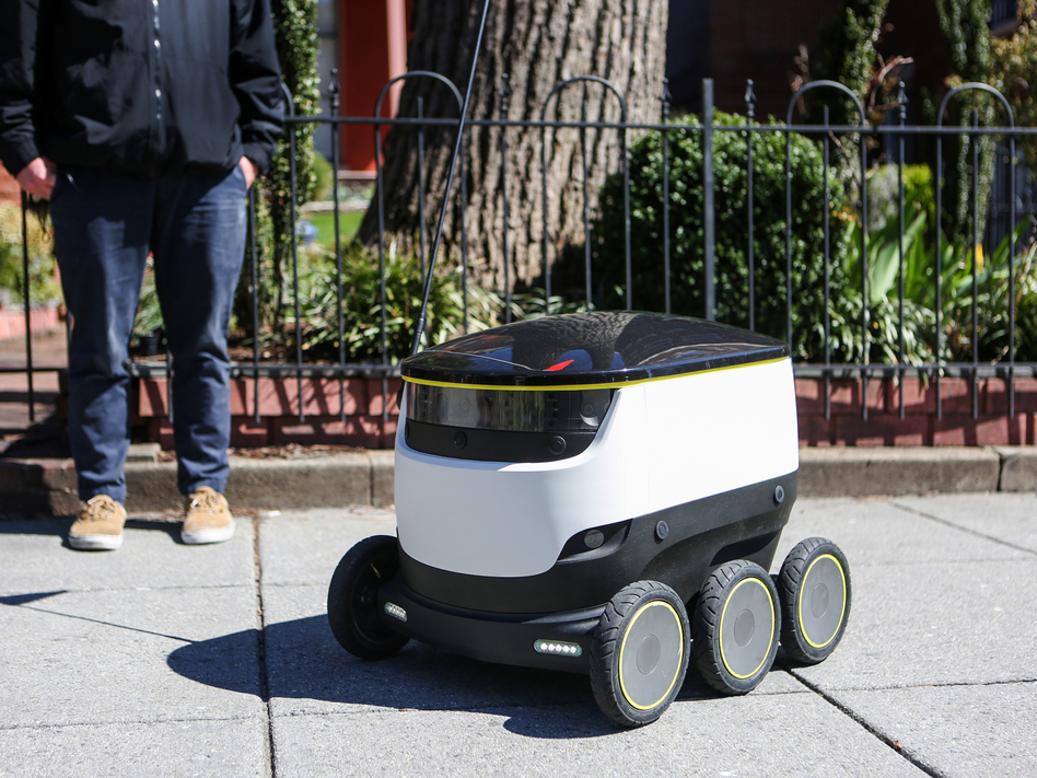 Starship Technologies' delivery robots, which can be found traveling the sidewalks of Washington, D.C., get smarter the more they drive — learning about sidewalk and traffic patterns with every trip they take. (Meg Kelly/NPR)
