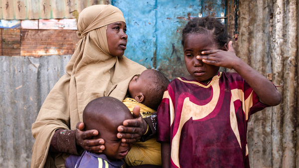 Fatun Mohamed Sareye, 30, sits with her family at a camp for internally displaced people in Garowe, Somalia.