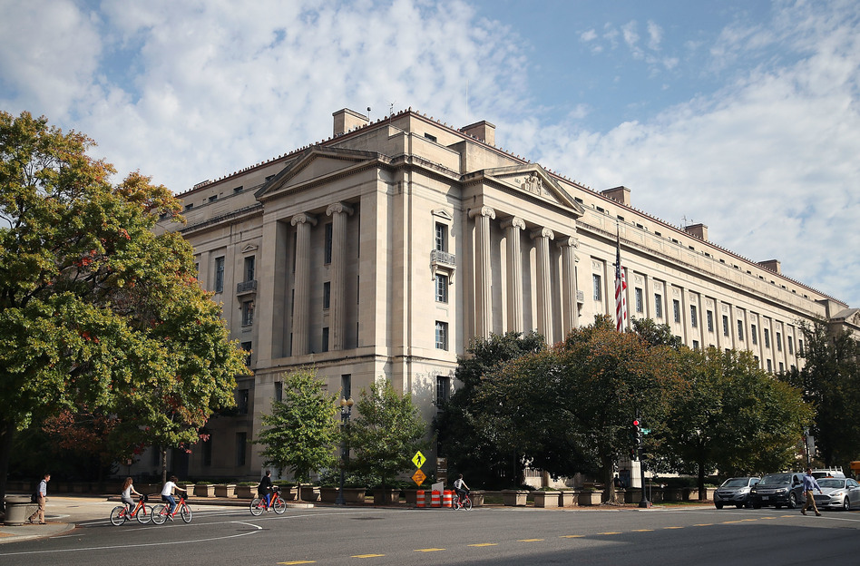 The U.S. Department of Justice is one of several parts of the government that have the power to hold the president and his appointees accountable on ethics. (Mark Wilson/Getty Images)