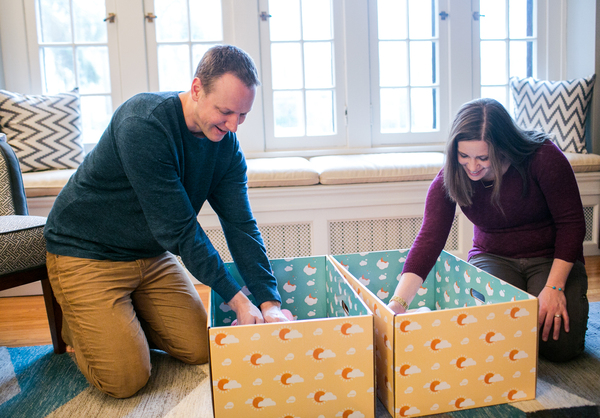 Dave and Kyle Stimpert check on Ryan and Nell. They received the free boxes after learning about preventing SIDS through safe sleep practices.