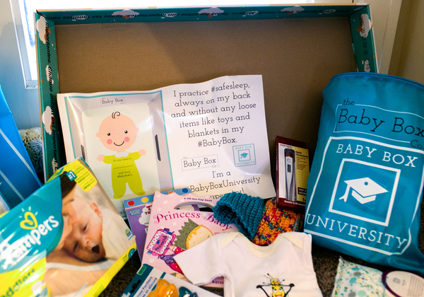 In Ohio, the free baby box comes with educational materials, books, diapers, wipes and clothes.