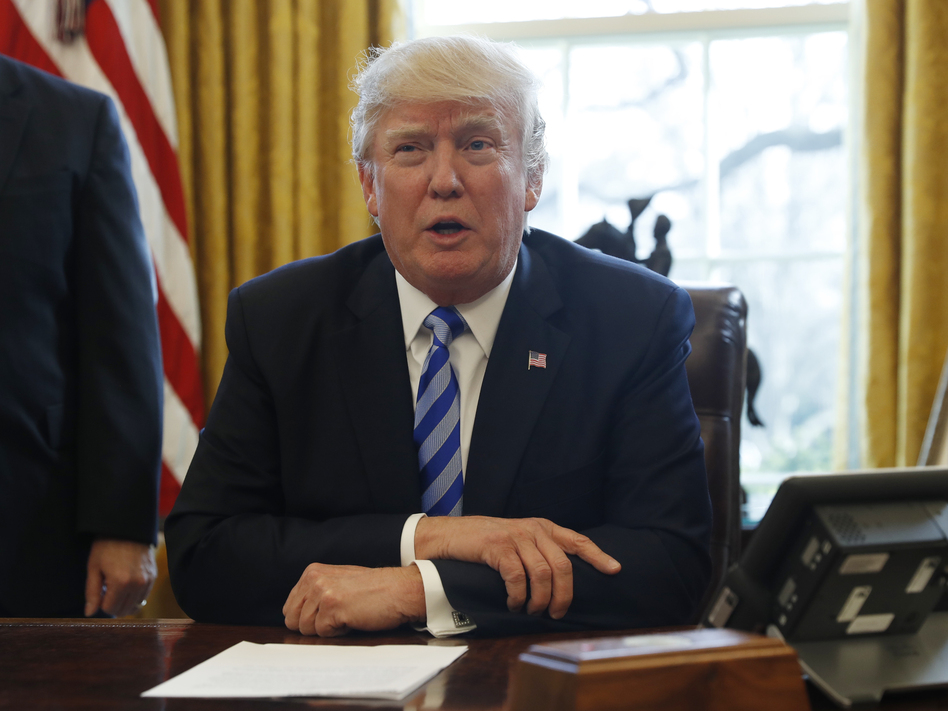 President Trump speaks to the media in the Oval Office on Friday. (Pablo Martinez Monsivais/AP)