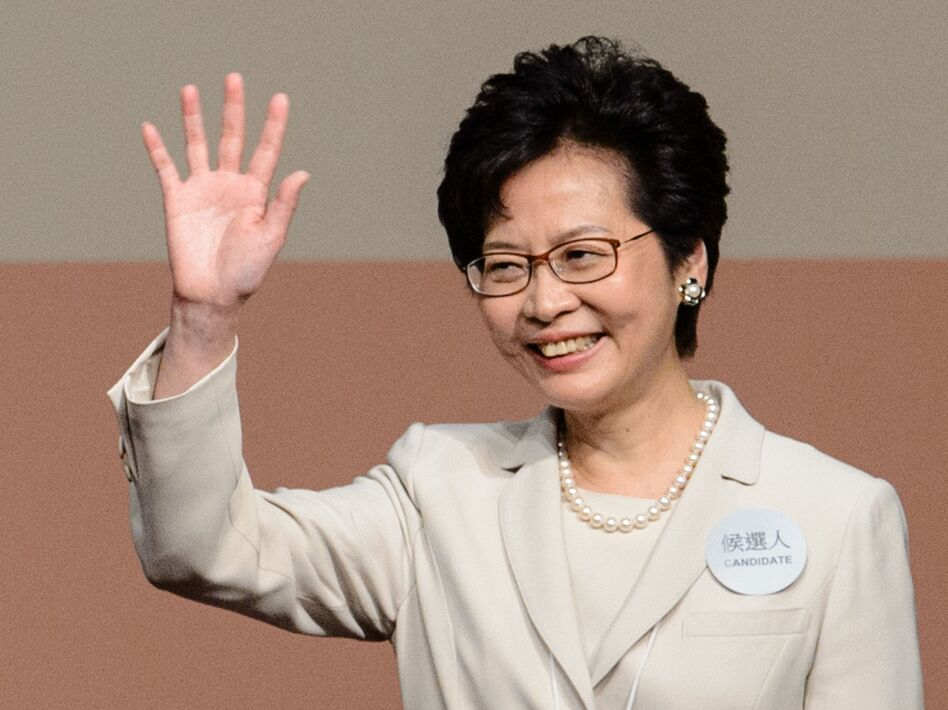Hong Kong's new chief executive Carrie Lam waves after she won the Hong Kong chief executive election in Hong Kong on March 26, 2017. Hong Kong's new leader Carrie Lam pledged on March 26 to mend political rifts after winning a vote dismissed as a sham by democracy activists who fear the loss of the city's cherished freedoms. (Anthony Wallace/AFP/Getty Images)
