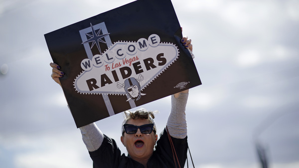 A fan celebrates Monday in Las Vegas, after NFL team owners approved the Raiders