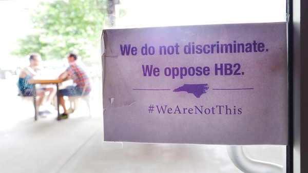 """The """"We Are Not This"""" slogan is posted at the entrances to Bull McCabe"""