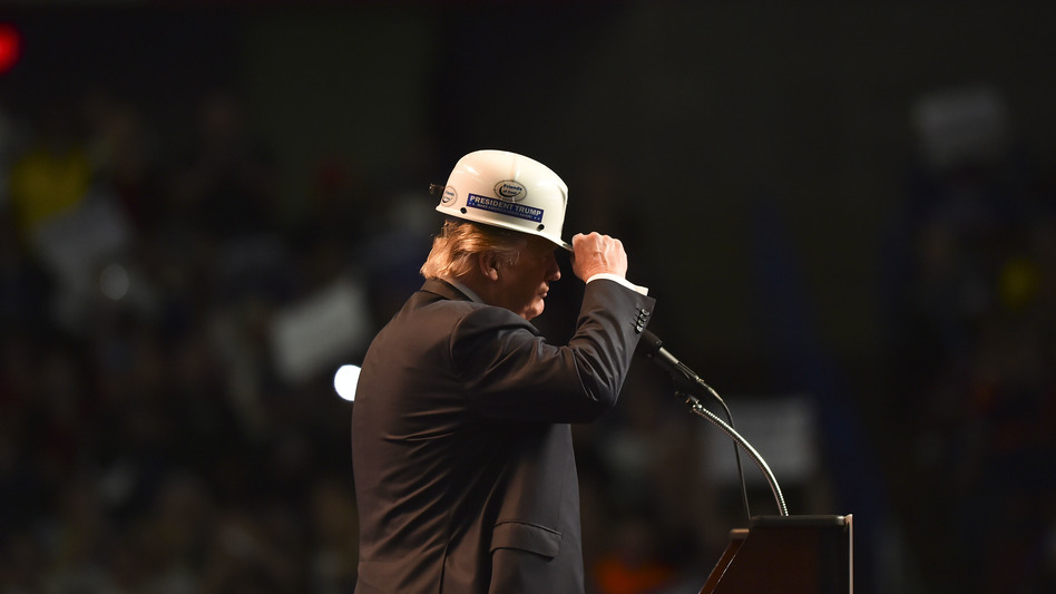 Donald Trump wears a coal miner's protective hat while addressing supporters at a rally in Charleston, W.V., last May. (Ricky Carioti/The Washington Post via Getty Images)