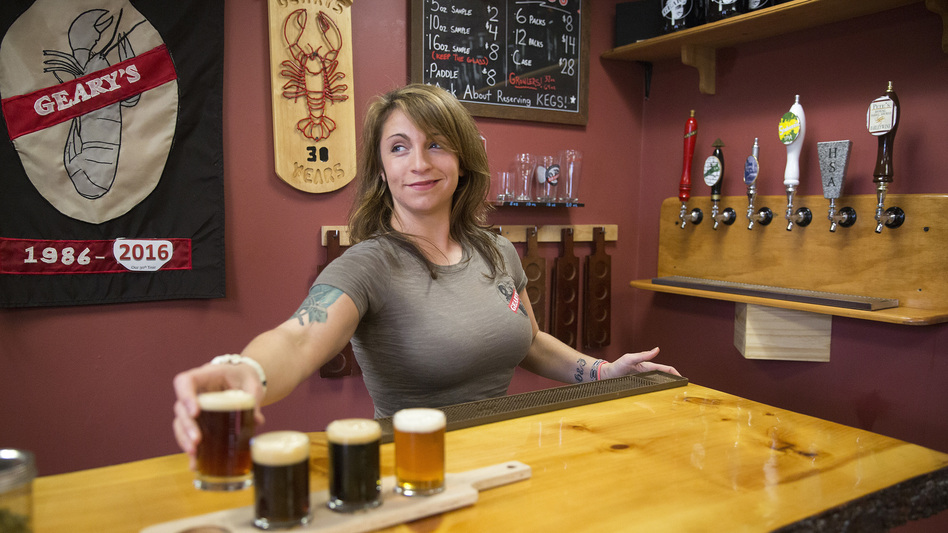 Craft breweries now account for 5,234 of 5,301 U.S. beer makers, according to an industry group's annual tally. Here, Danielle Coons, the tasting room ambassador at D.L. Geary Brewing Co.<strong> </strong>serves a beer in Portland, Maine, last November. (Brianna Soukup/Portland Press Herald via Getty Images)