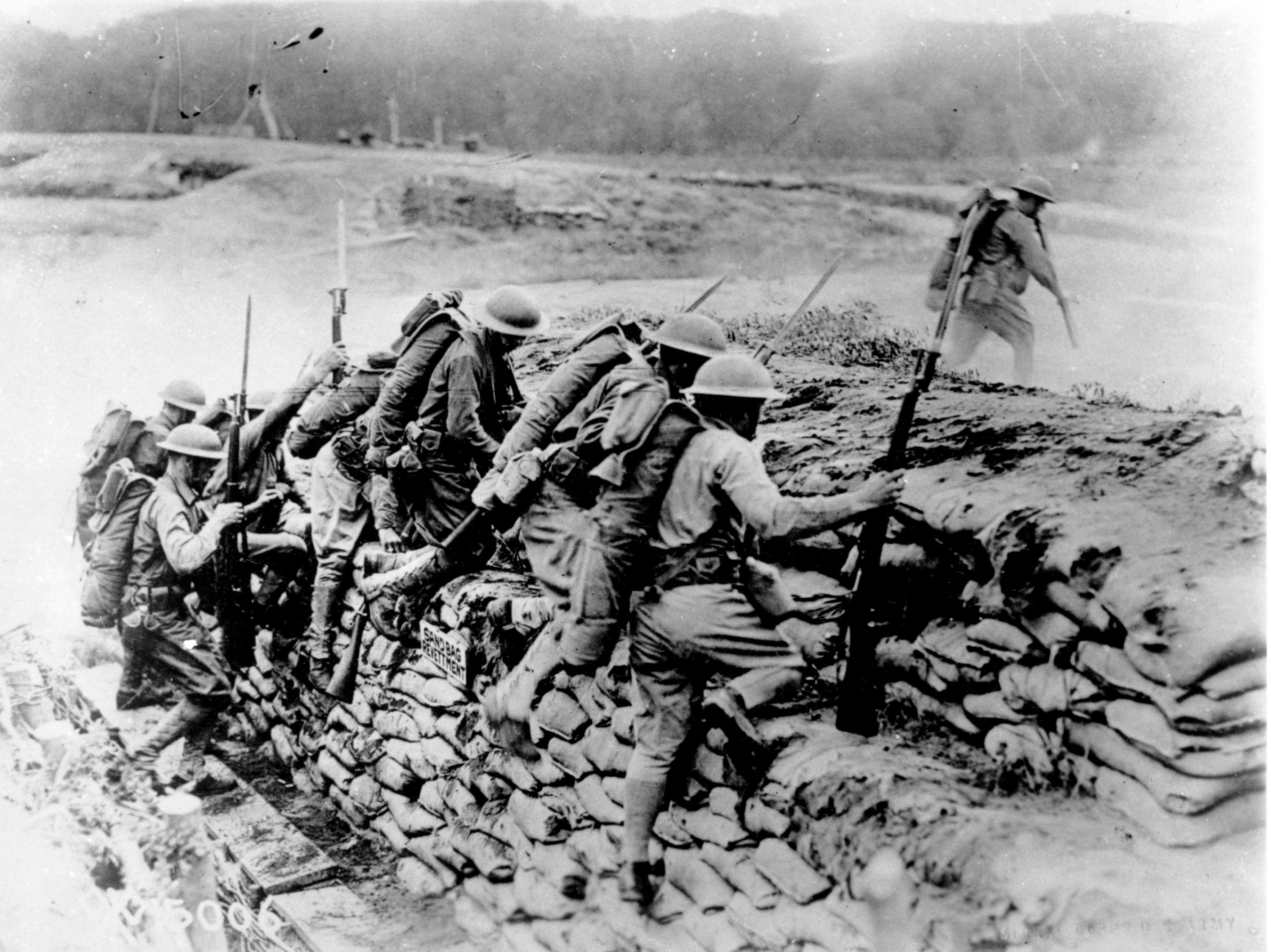 American troops climb over a sandbag barrier in France during World War I in 1918. The U.S. waited almost three years before entering the war, but the fresh American troops played a major role in deciding the outcome of a conflict that has been locked in stalemate. April 6 marks the 100th anniversary of the U.S. entrance into the war. (AP)