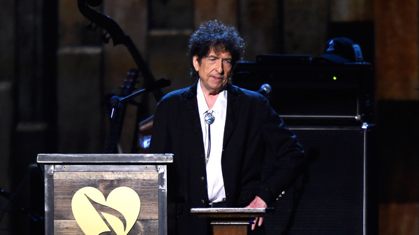 Bob Dylan speaks onstage at the MusiCares 2015 Person Of The Year Gala in Los Angeles. Dylan was awarded the Nobel Prize in Literature in October — though he has not yet accepted it. The Swedish Academy has announced he plans to do so this weekend in Stockholm.